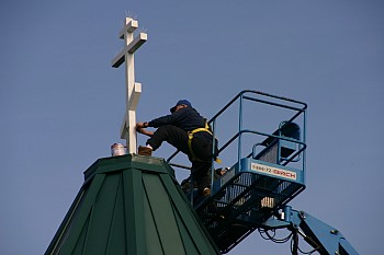 Church building completed with the installation of the cross